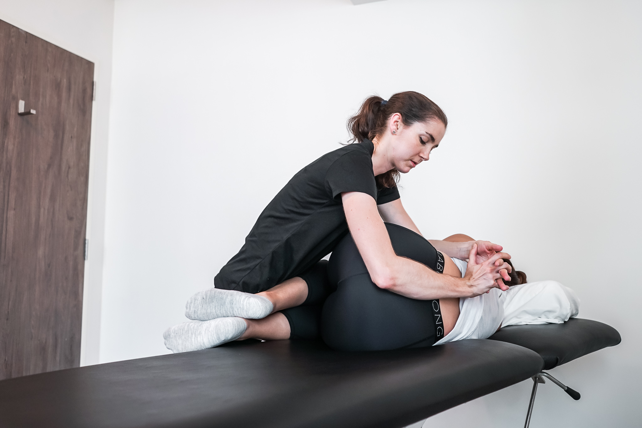 Osteopath fixing issues with a patient