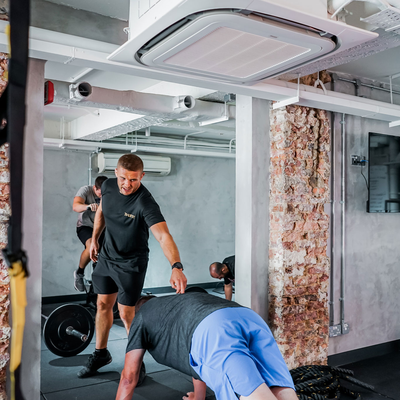 personal trainer guiding client on exercise