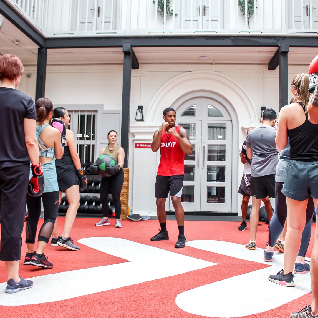 UFIT Box group class at club street courtyard