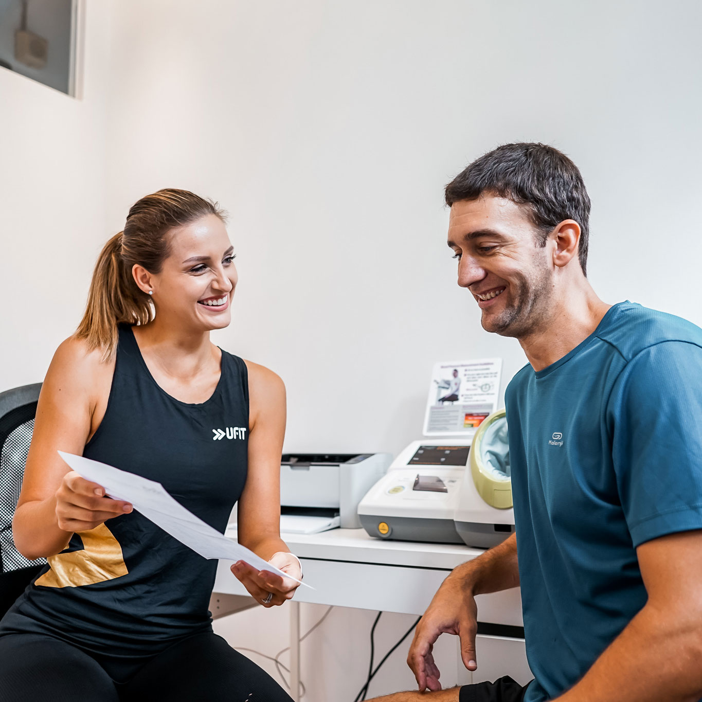 Woman with health analysis report and client