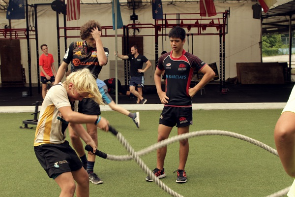 Jules training with the battle ropes at the training.